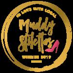 muddy stilettos badge